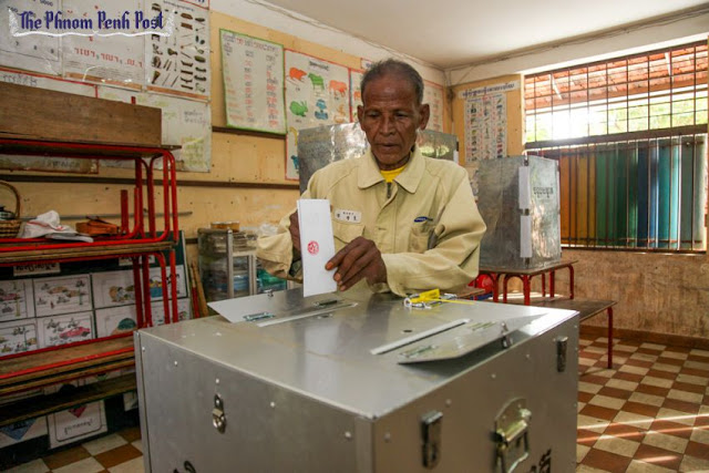 A man places his vote in a ballot box in Kampong Cham during the 2013 national election. Heng Chivoan