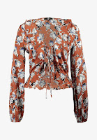 https://www.zalando.be/missguided-floral-wrap-ruffle-blouse-blouse-brown-m0q21e068-o11.html