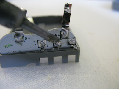 Removal of Circuit Board From DSLR Camera Battery