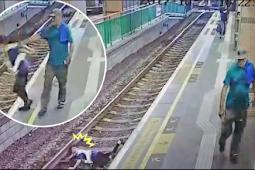 Wanita Pekerja MTR, Di Dorong jatuh Ke Rel Oleh Seorang Pria Pakistan