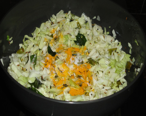 add cabbage and turmeric powder