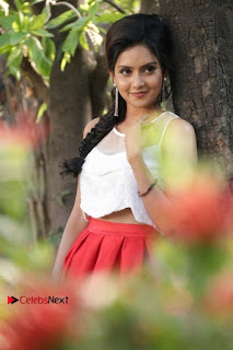 Actress Mahima Nambiar Latest Stills in White Top and Red Skirt at Kuttram 23 Movie Press Meet  0010.jpg