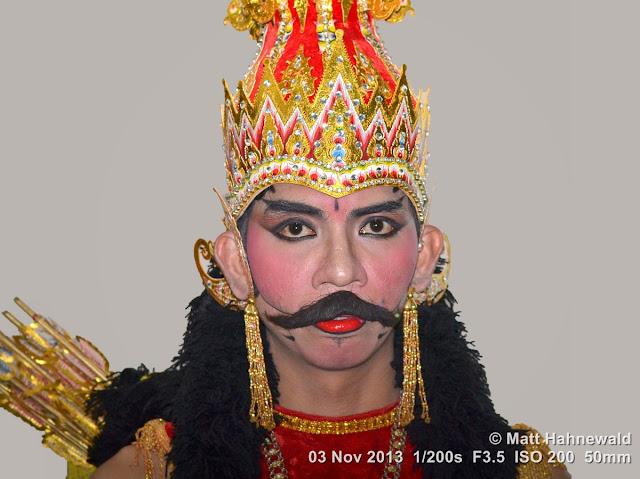 photo, portrait, Facing the World, © Matt Hahnewald, artist, 50 mm prime lens, Nikon DSLR D3100, fake moustache, headgear, Indonesia, wayang wong, Surakarta, Sriwedari Theatre, Javanese dance, Mahabharata, wayang orang, Ramayana, dancer, performer, posing