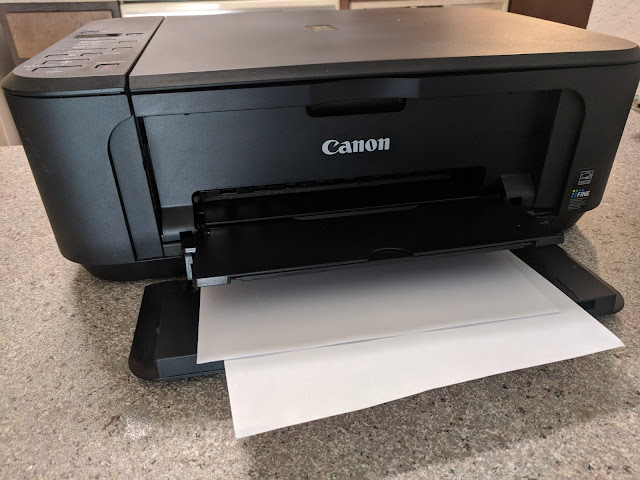 Impresora Canon con páginas en blanco.