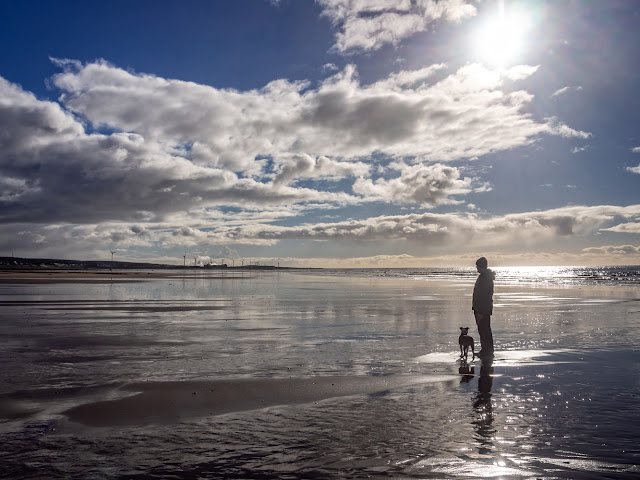 Photo of reflections in the wet sand on the shore at Maryport