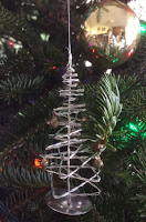 silvery wire Christmas tree ornament on tree