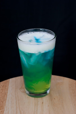 alien urine sample cocktail, coconut rum, malibu rum, melon liqueur, banana liqueur, peach schnapps, sweet & sour juice, soda water, blue curacao