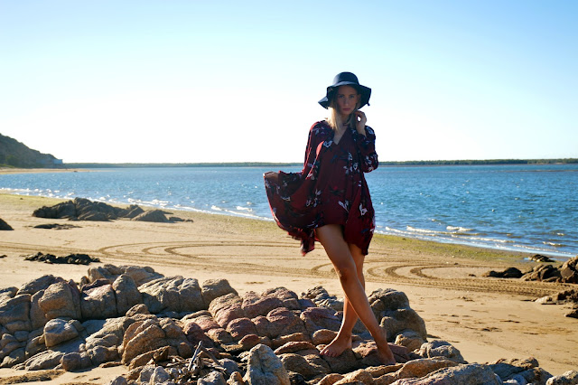boho oversized wine floral dress with choker neck worn as beach coverup with navy floppy hat
