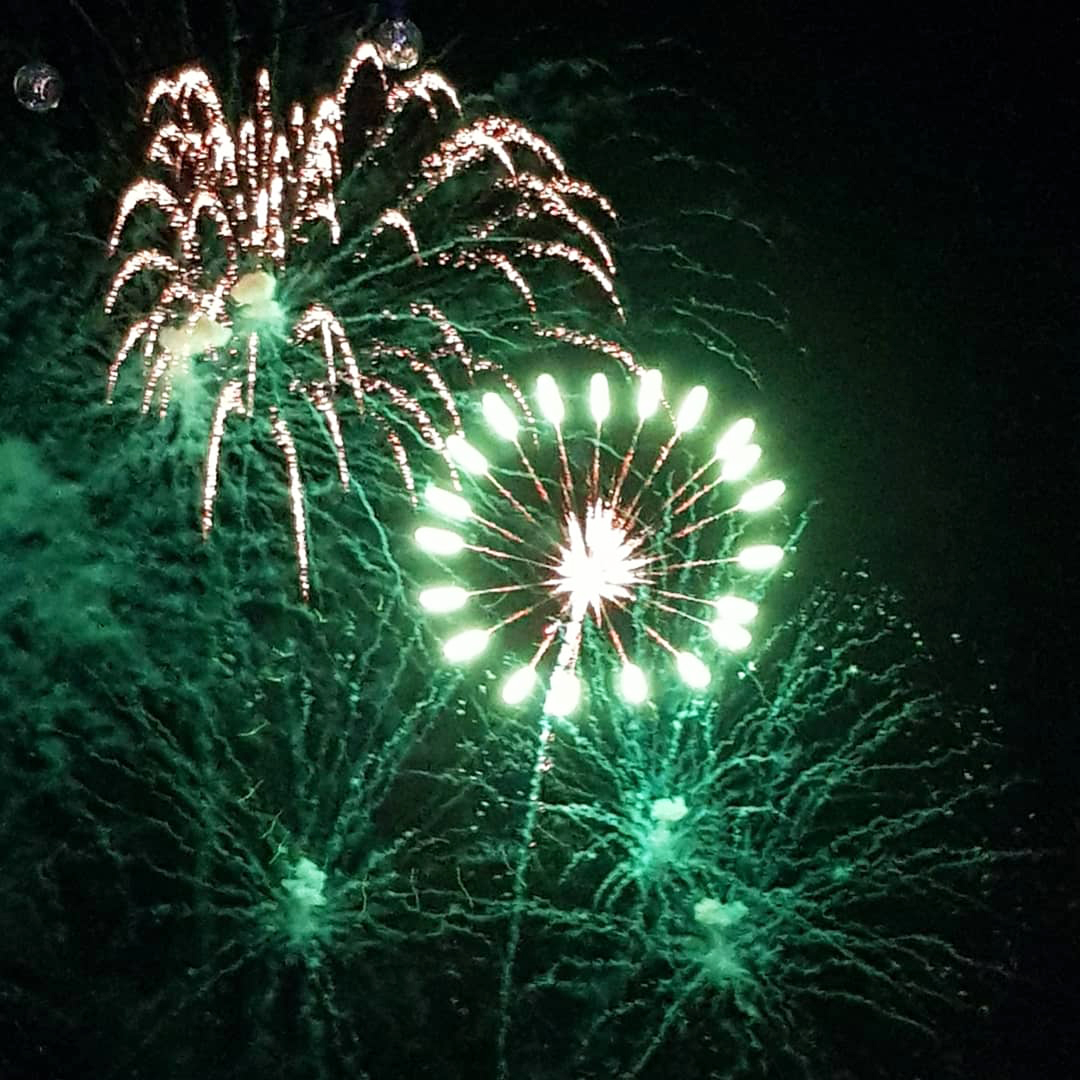 Green fireworks light up the sky above Miami