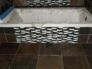 front of tub with glass tile
