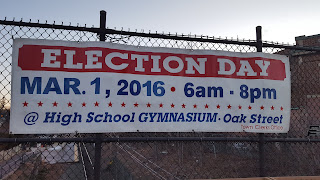 the election day sign on the railroad bridge
