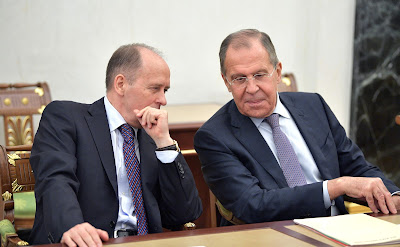 Director of the Federal Security Service Alexander Bortnikov and Foreign Minister Sergei Lavrov at a meeting with permanent members of Security Council.