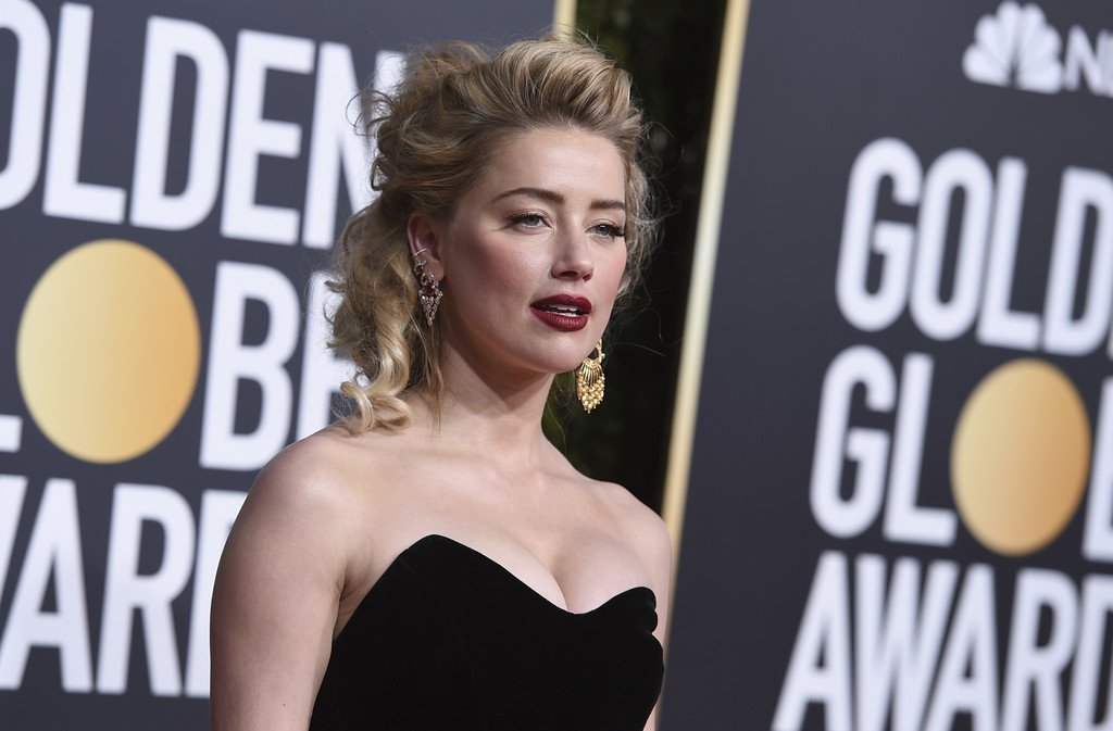 612b026cdbb Amber Heard oozes sex appeal as she goes strapless for the 2019 Golden  Globes