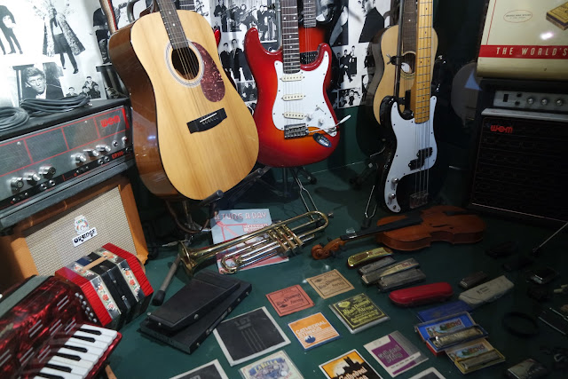 music shop with electric and acoustic guitars and CDs