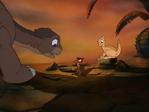 three dinosaurs in The Land Before Time 1988 animatedfilmreviews.filminspector.com