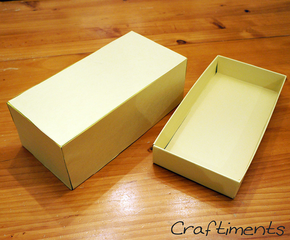 Cover shoebox with construction paper