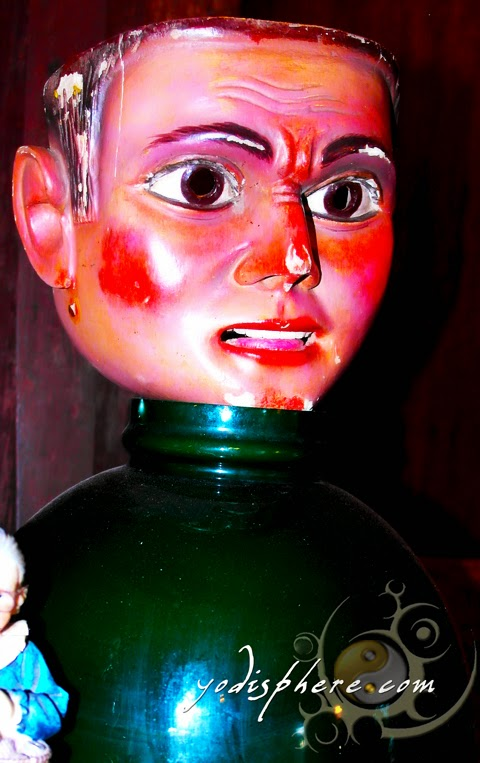 Figurine with blistered face