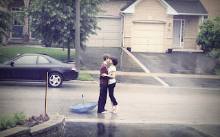Teenage-boy-and-girl-kiss-each-other-in-rain-before her-house-HD-image.jpg
