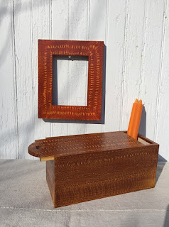 Wooden box and wooden picture frame painted orange with yellow graining