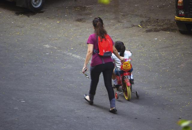 student, school, nursery, cycle, riding, morning, bandra east, mumbai, india, street, street photo, street photography,