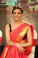 Kajal Aggarwal in Red Saree Sleeveless Black Blouse Choli at Santosham awards 2017 curtain raiser press meet 02.08.2017 084.JPG