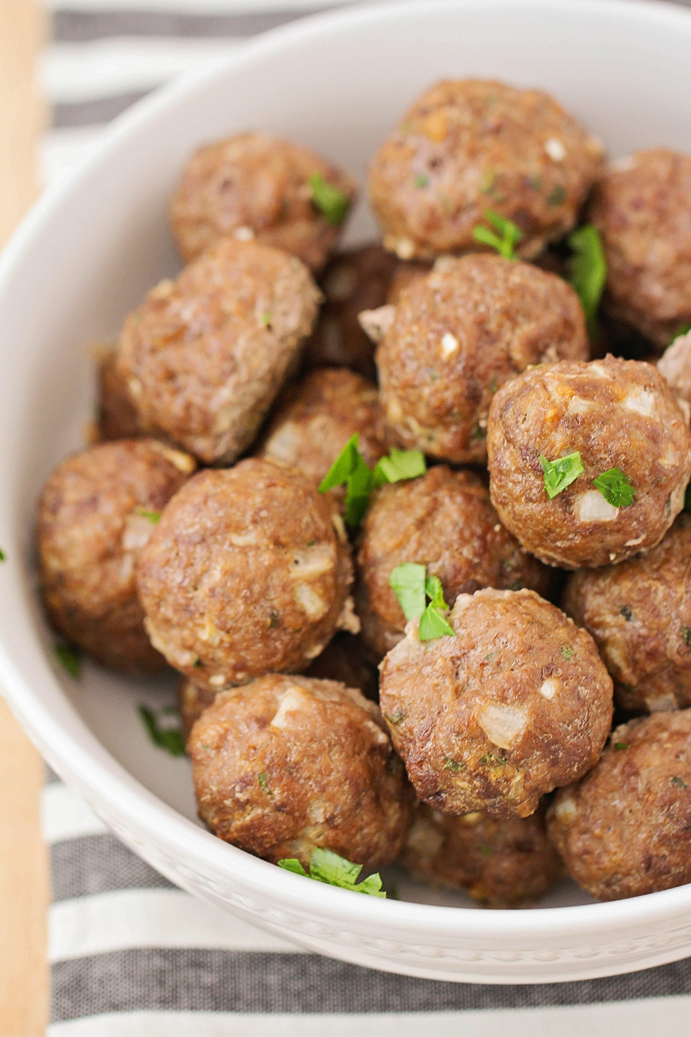 These freezer-friendly baked meatballs are totally delicious and perfect for swedish meatballs, spaghetti, and more!