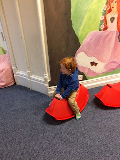 Toddler playing on a rocking toy