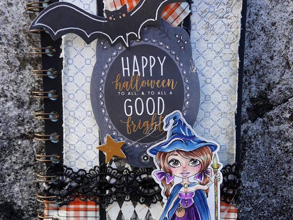"""A halloween notebook, with the """"traveling witch"""" stamp."""