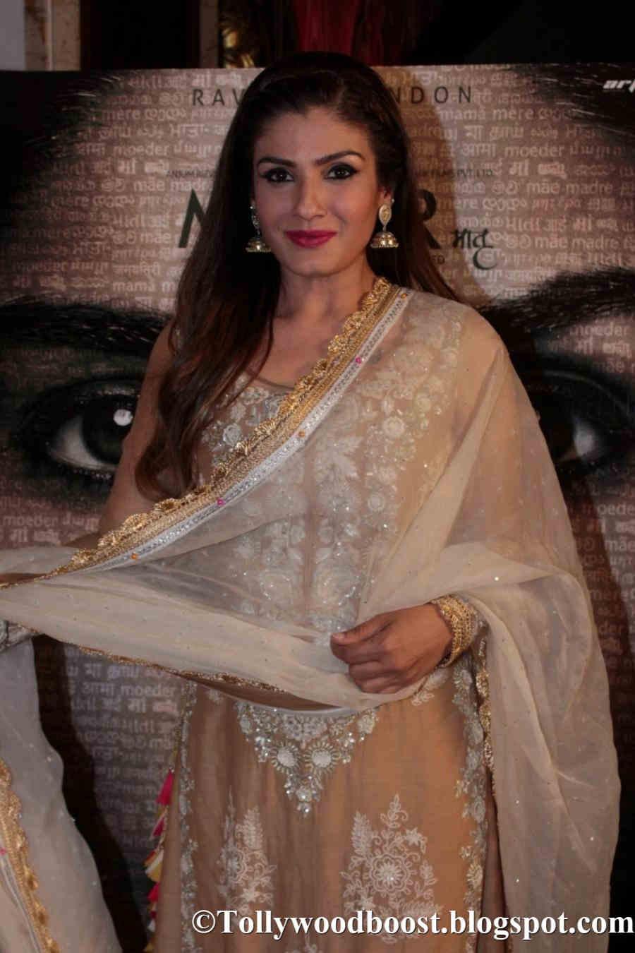 Actress Raveena Tandon At Mumbai Press Conference In White Dress