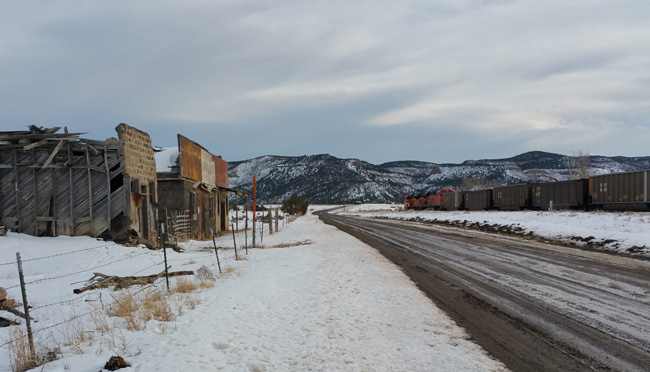 A train passes the abandoned buildings of Ludlow Colorado Ghost Town