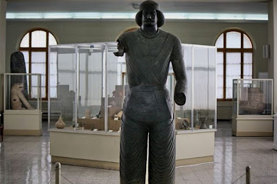 The stone statue in the National Museum of Iran.