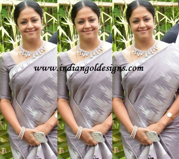 Latest saree designs jyothika in gray designer saree checkout jyothika in gray designer saree with pochampally border and paired with matching half sleeves blouse altavistaventures Image collections