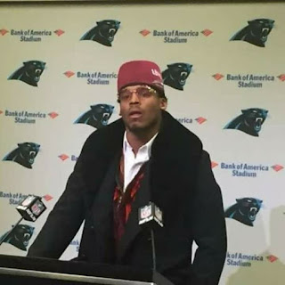 carolina panthers quarterback cam newton wearing fez