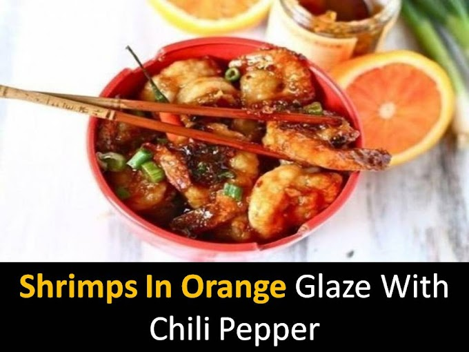 Shrimps in orange glaze with chili pepper
