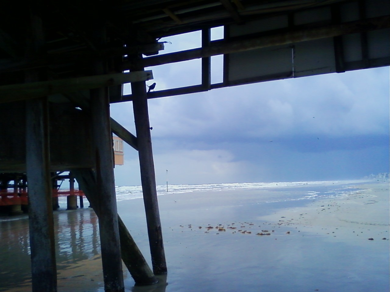 A Stormy Day Or Rather Rain Squalls T Storms In The Distance During Variable Weather As Seen From Underneath Daytona Beach Pier Also