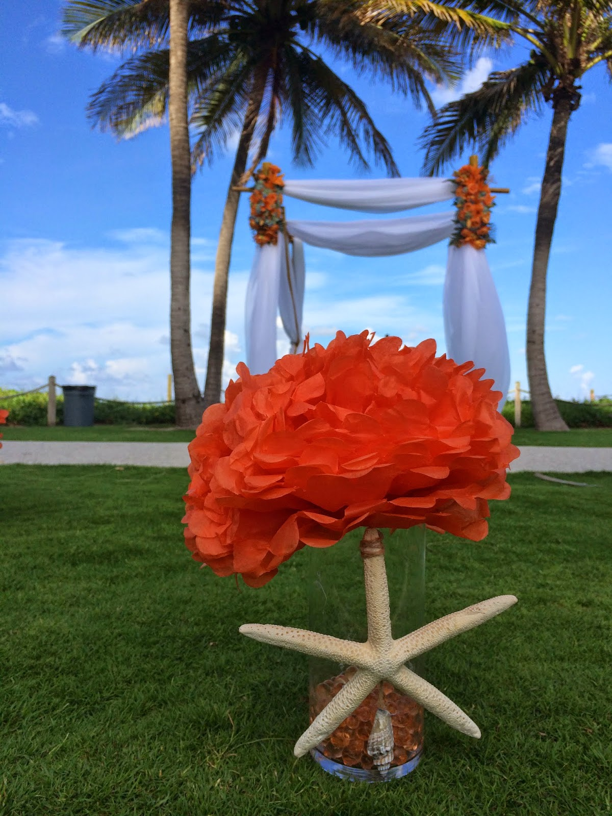 Beach wedding bamboo gazebo with flower and white folding chair