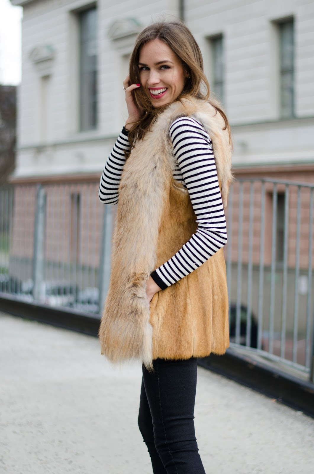 kristjaana mere black white striped sweater fox fur vest winter fashion