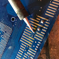 Heating the joint with the soldering iron