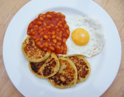 Scottish Tattie Scones on a plate with a fried egg and baked beans