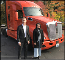 Kenworth Engineers Patrick Dean and Lizbeth Davern stand with a T680