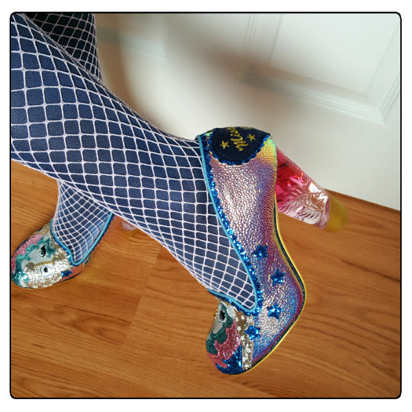 wearing holographic unicorn shoes with metallic and fishnet tights