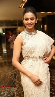 Actress Rakul Preet Singh Stills in White Dress at Winner Pre Release Function  0020.jpg
