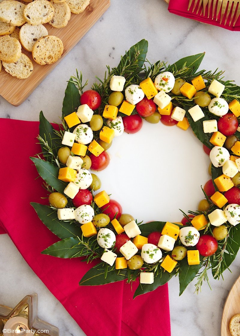 Christmas Wreath Cheese Platter Appetizer - an easy to assemble cheese board recipe that is very festive and perfect for holiday parties! by BirdsParty.com @birdsparty #holidaywreath #christmaswreath #cheesewreath #cheeseboard #cheeseplatter #holidaycheesewreath #christmascheesewreath #christmasappetizer #holidayappetizer #holidayrecipe #cheesewreathappetizer