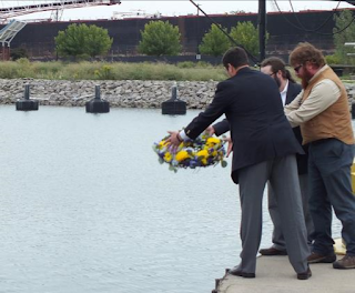 Floral wreath dropped into the water to honor Battle of Lake Erie