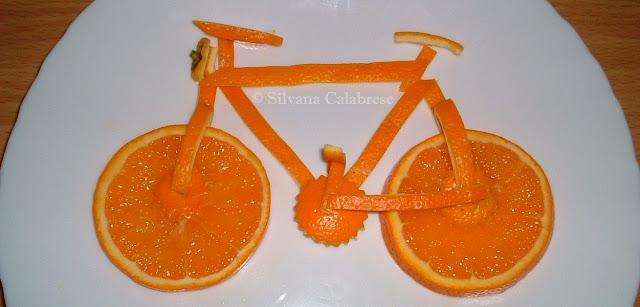 Bicicletta con arancia - Silvana Calabrese Blog