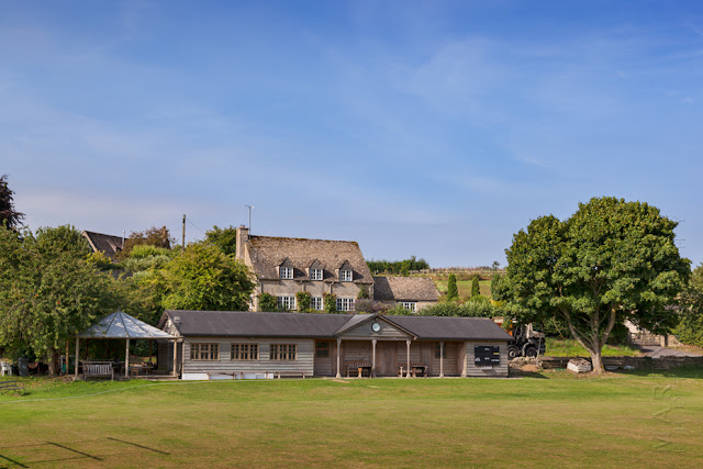 Swinbrook village cricket green in the Cotswolds by Martyn Ferry Photography