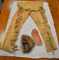 Cheerleader costume consisting of leggings and moccasins.
