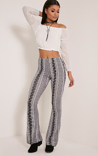 http://www.awin1.com/cread.php?platform=dl&awinmid=5577&awinaffid=245109&clickref=&p=https%3A%2F%2Fwww.prettylittlething.com%2Fabelle-monochrome-printed-jersey-flares.html