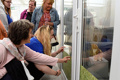 Visitors on a tour of Mitcham Homing Centre