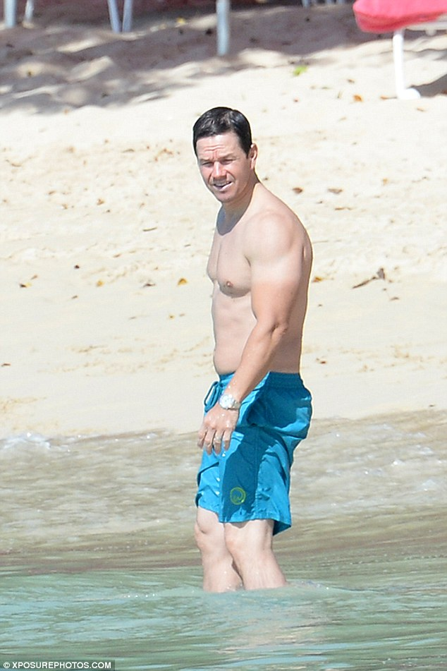 27697942 StarrLab: Mark Wahlberg shows off his bulging muscles while splashing  around in Barbados